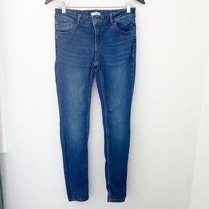 Ricki's Dark Wash Skinny Mid Rise Women's Jeans
